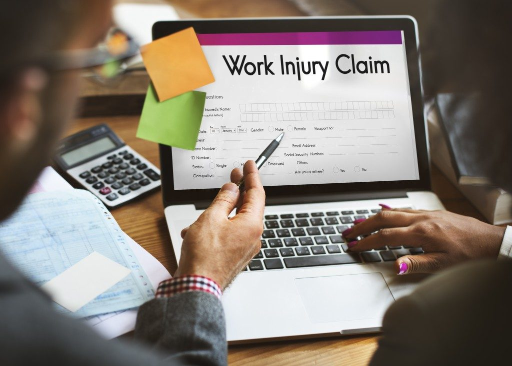 Person filling up a work injury claim