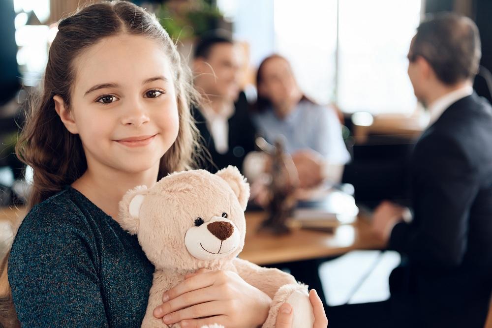 a girl holding her teddy bear