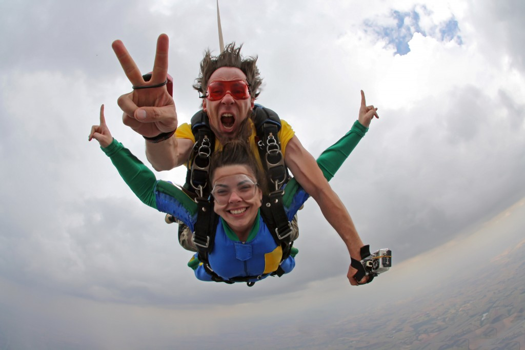 man and woman skydiving