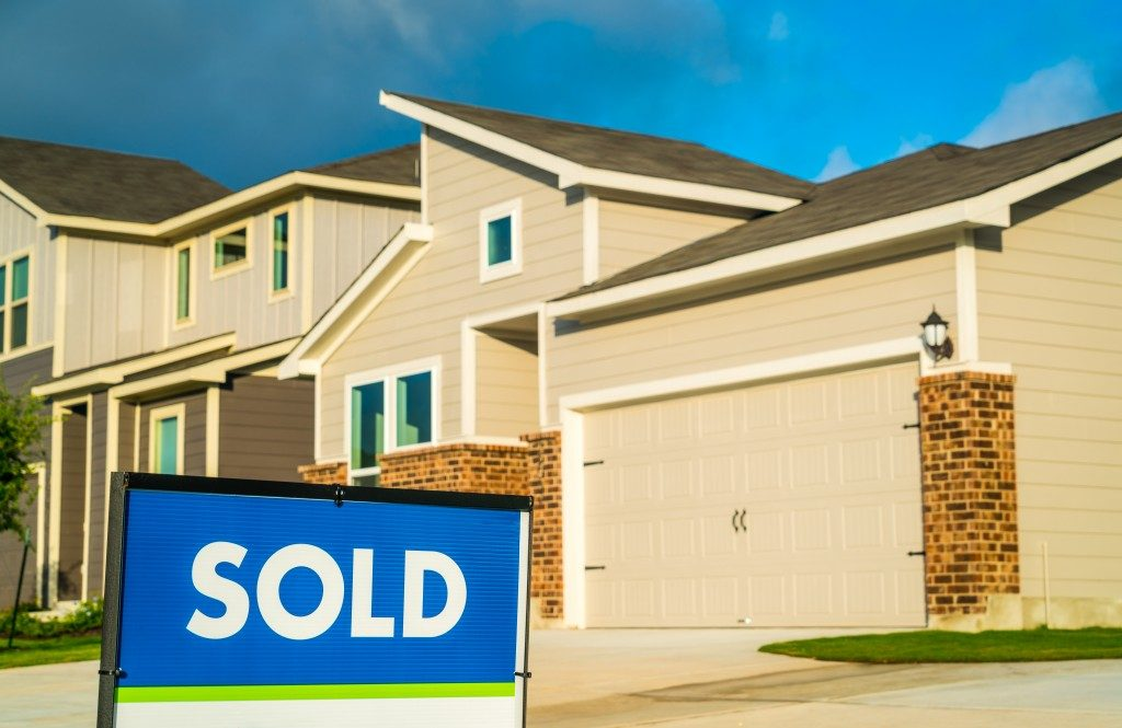 Sold sign in front of townhouse