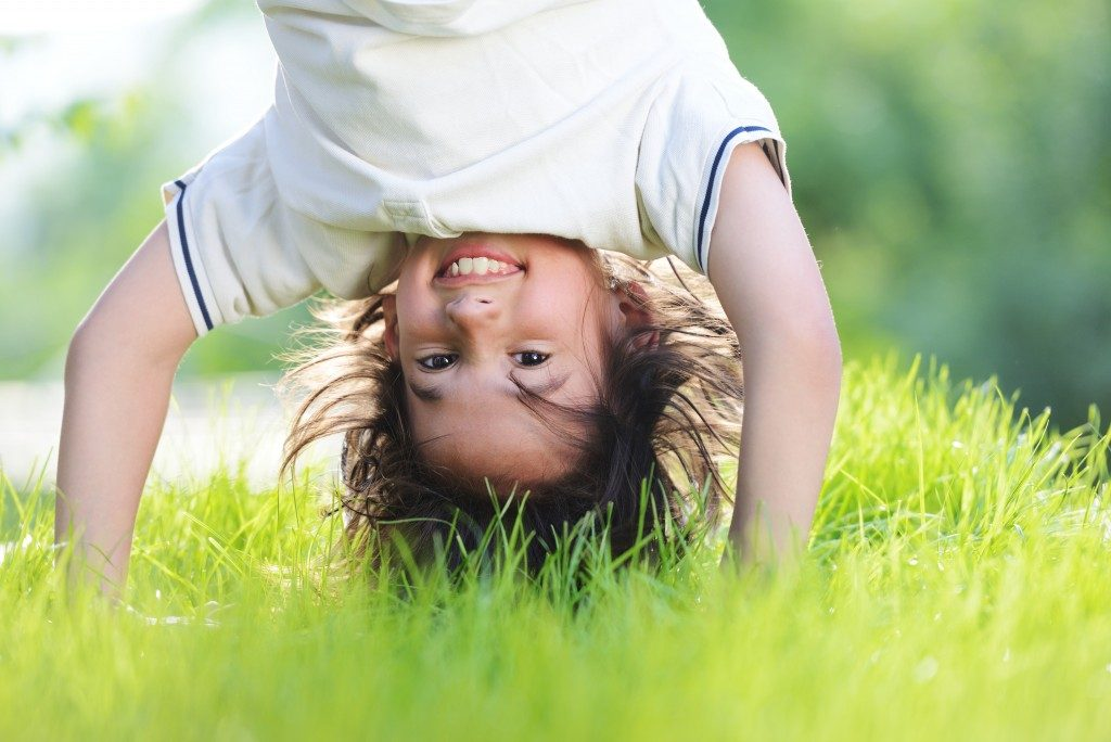 Kid playing in the grass