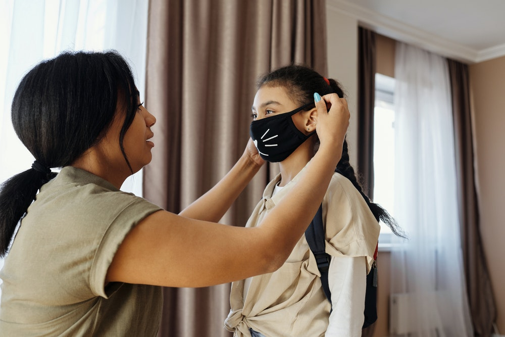 mother putting on a facemask