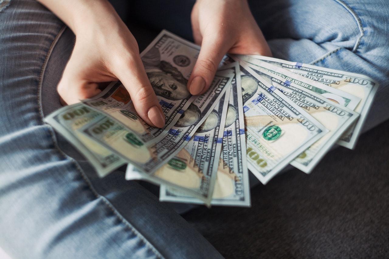 person holding bills