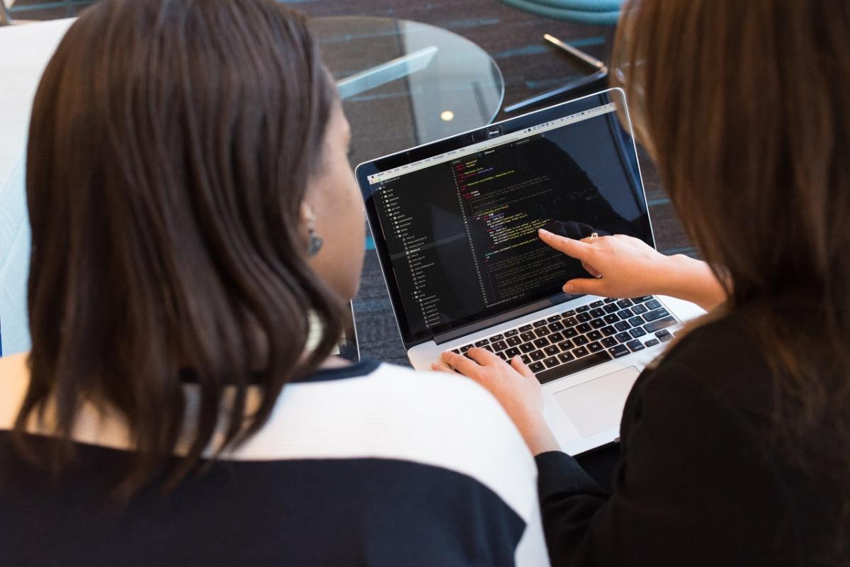 women writing codes