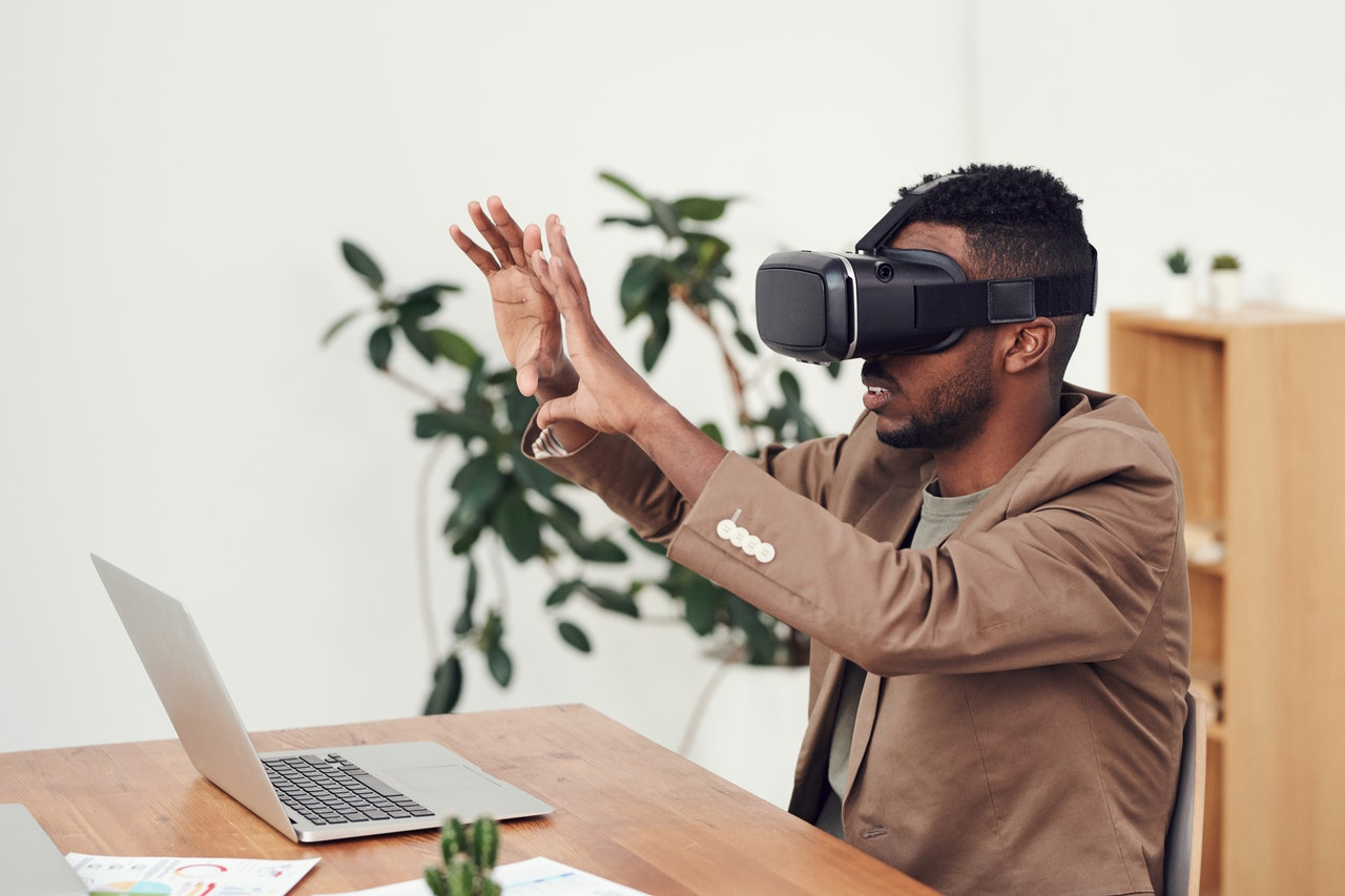 man interacting with vr headset