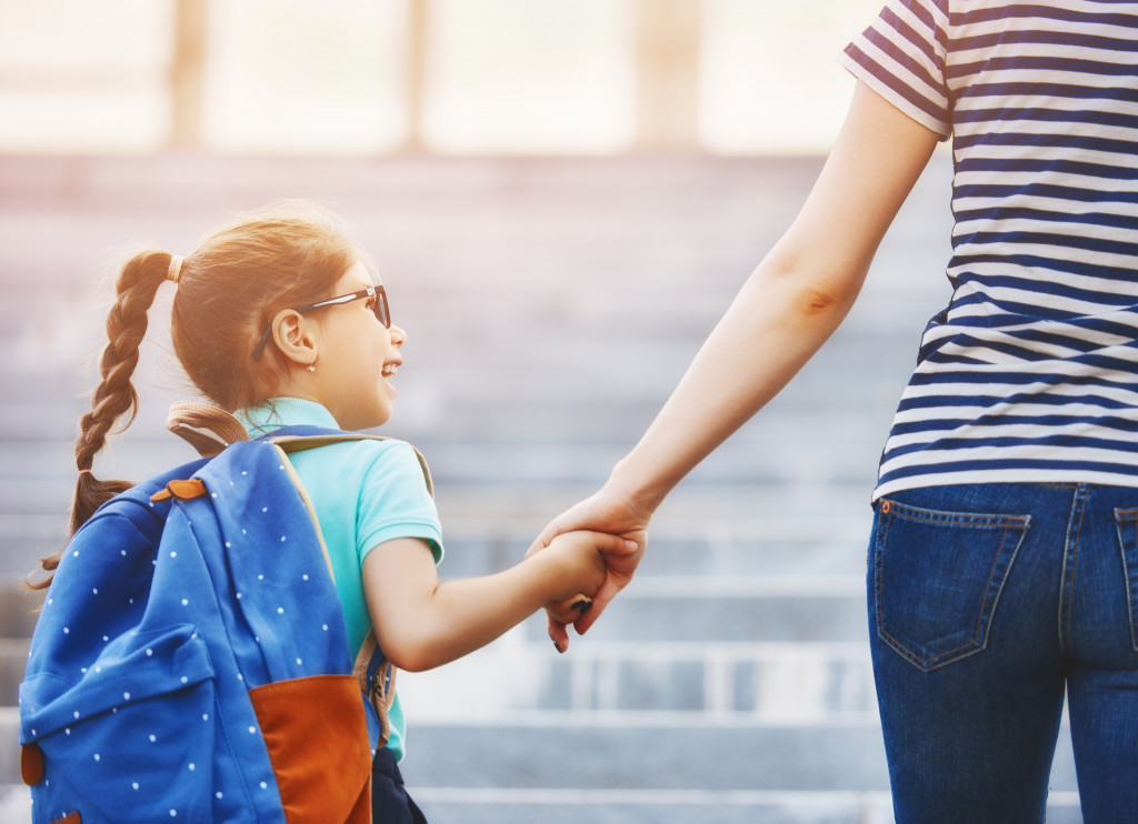 child holding parents hands
